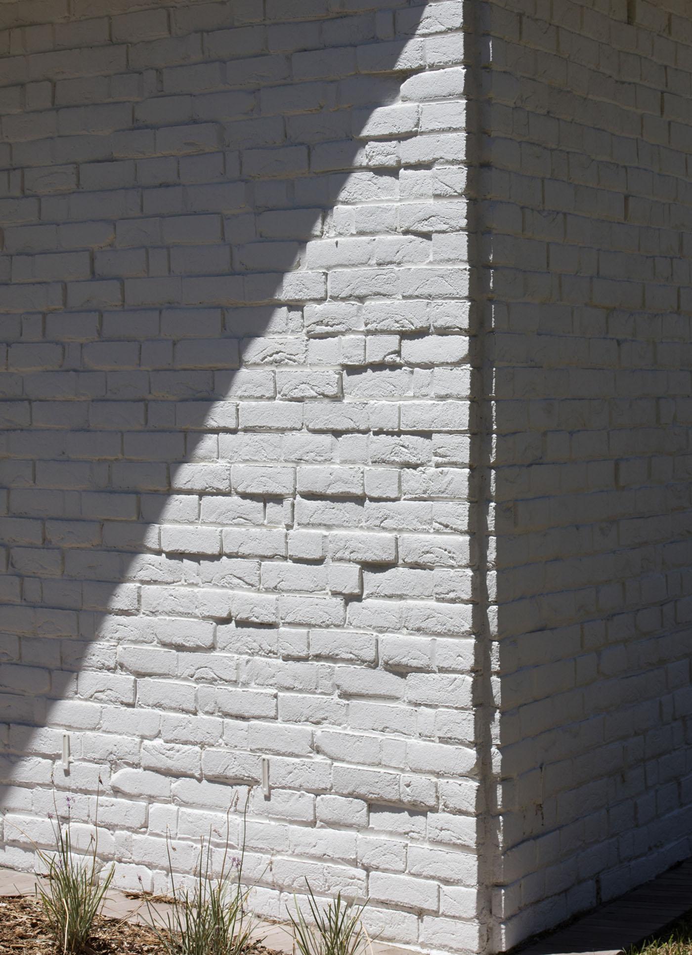 Sydenham Green Amenities by Sam Crawford Architects, Sydney. Rough textured bricks, painted white.
