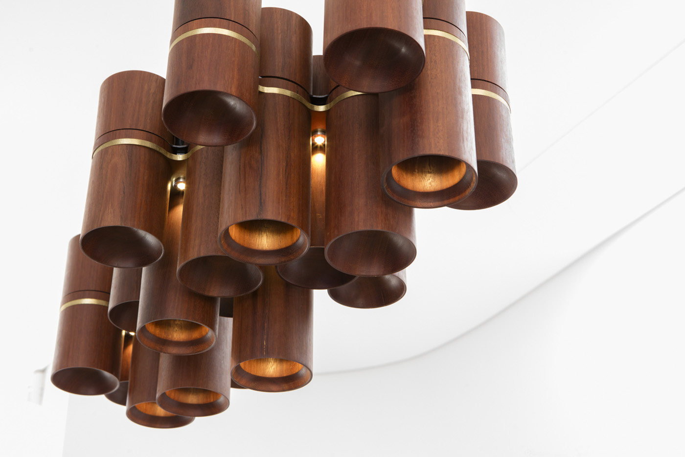 Dover Heights Pendants by award winning Sydney firm Sam Crawford Architects. Detail of recycle timber and brass pendant cluster.