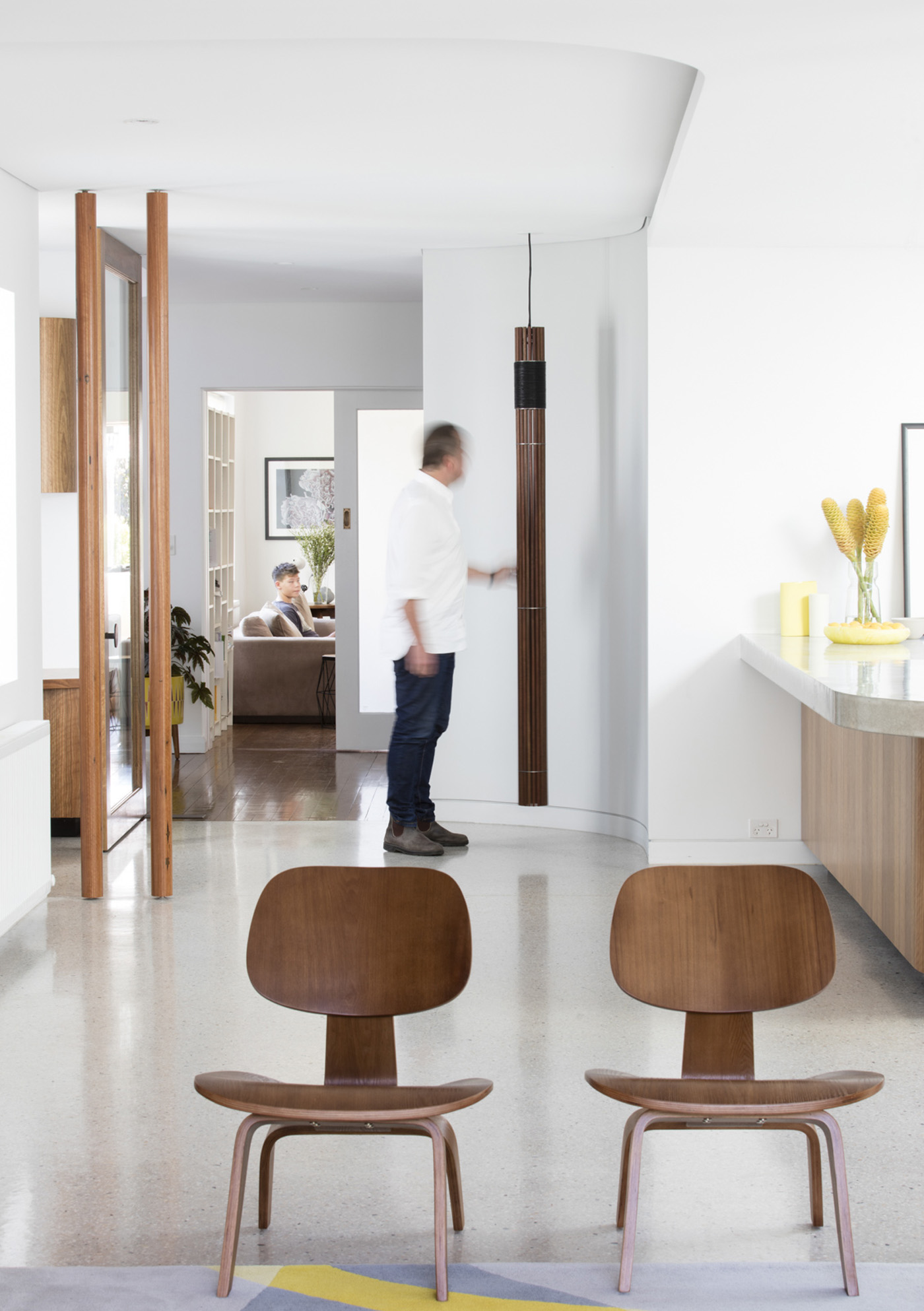 Dover Heights Pendants by award winning Sydney firm Sam Crawford Architects. Man interact with corner pendant