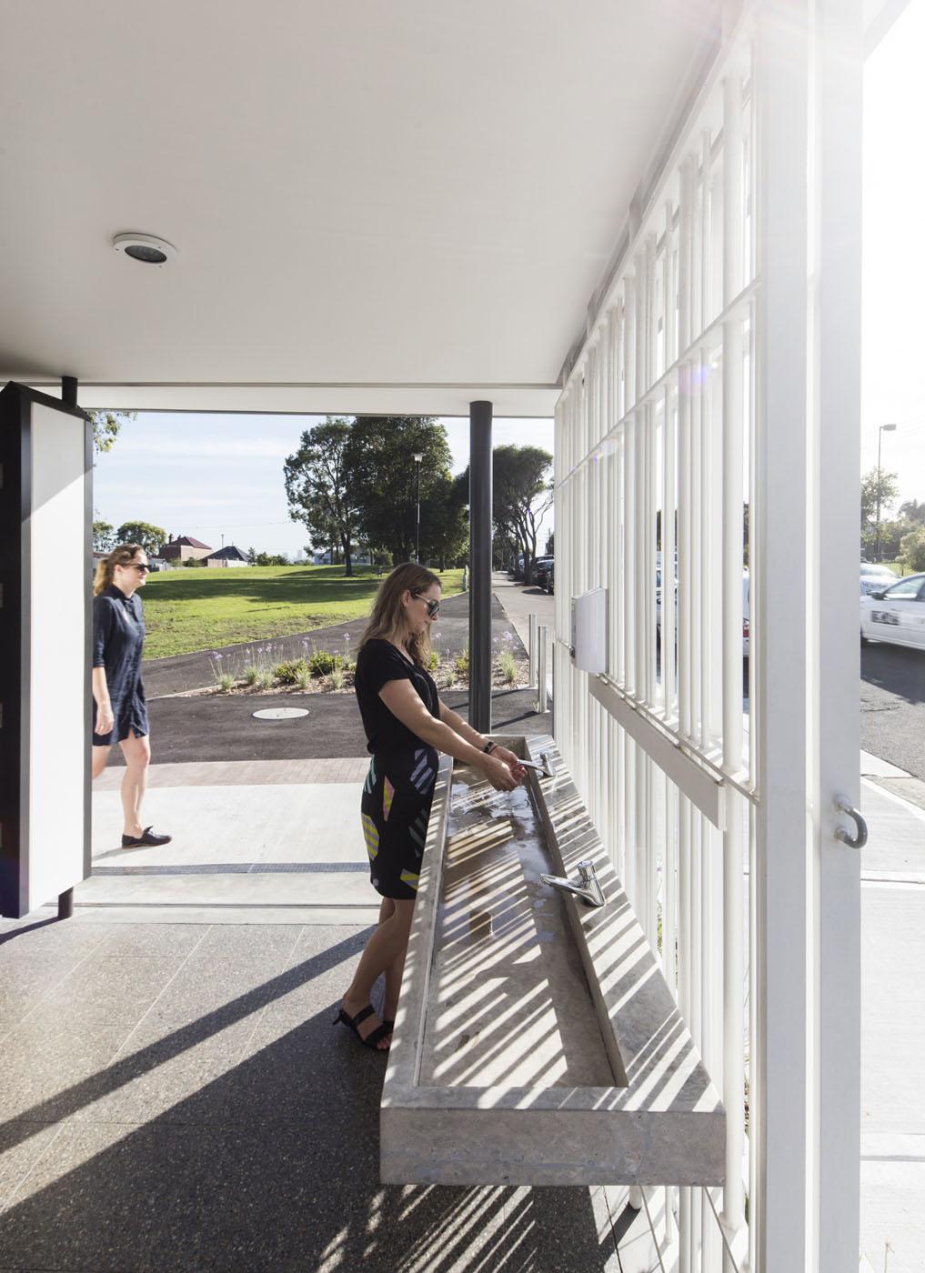 Sydenham Green Amenities by Sam Crawford Architects, Sydney. Concrete wash basin.