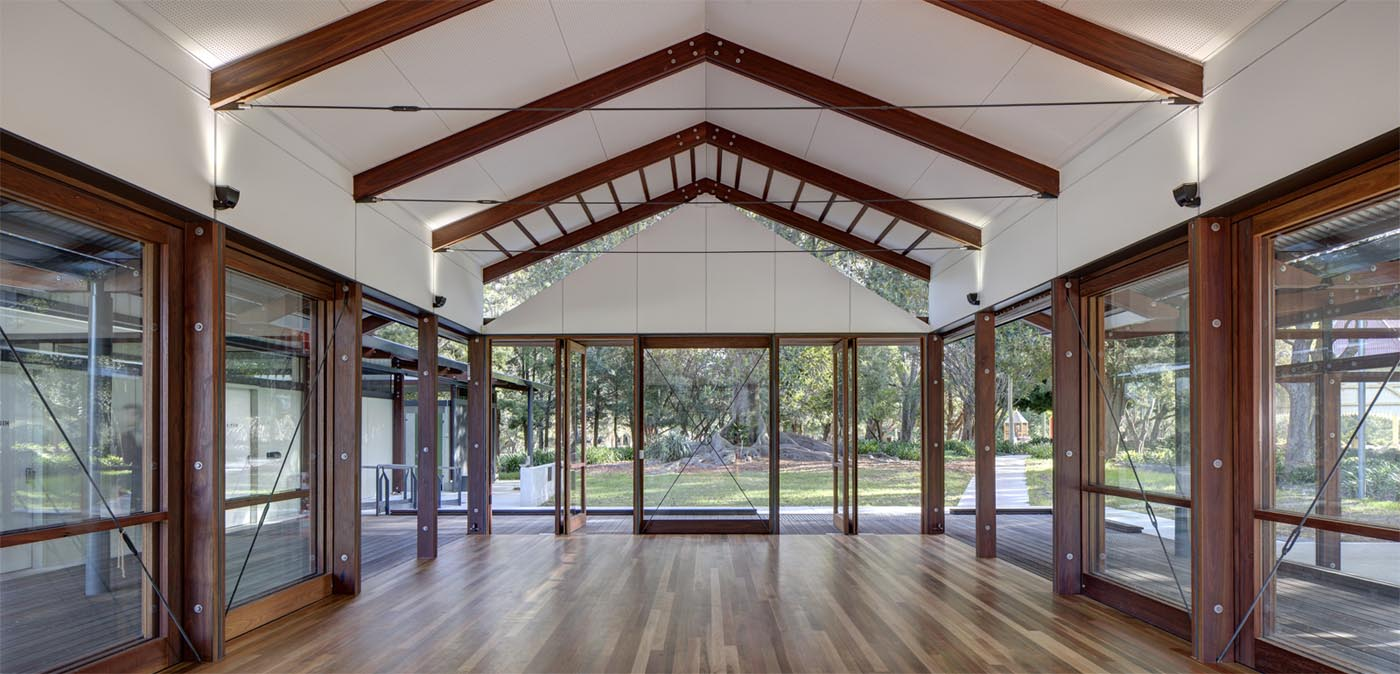 Cabarita Park Conservatory by award winning public architectural firm Sam Crawford Architects. Transparent glass doors and windows allow seamless view and connection from function room to the outside