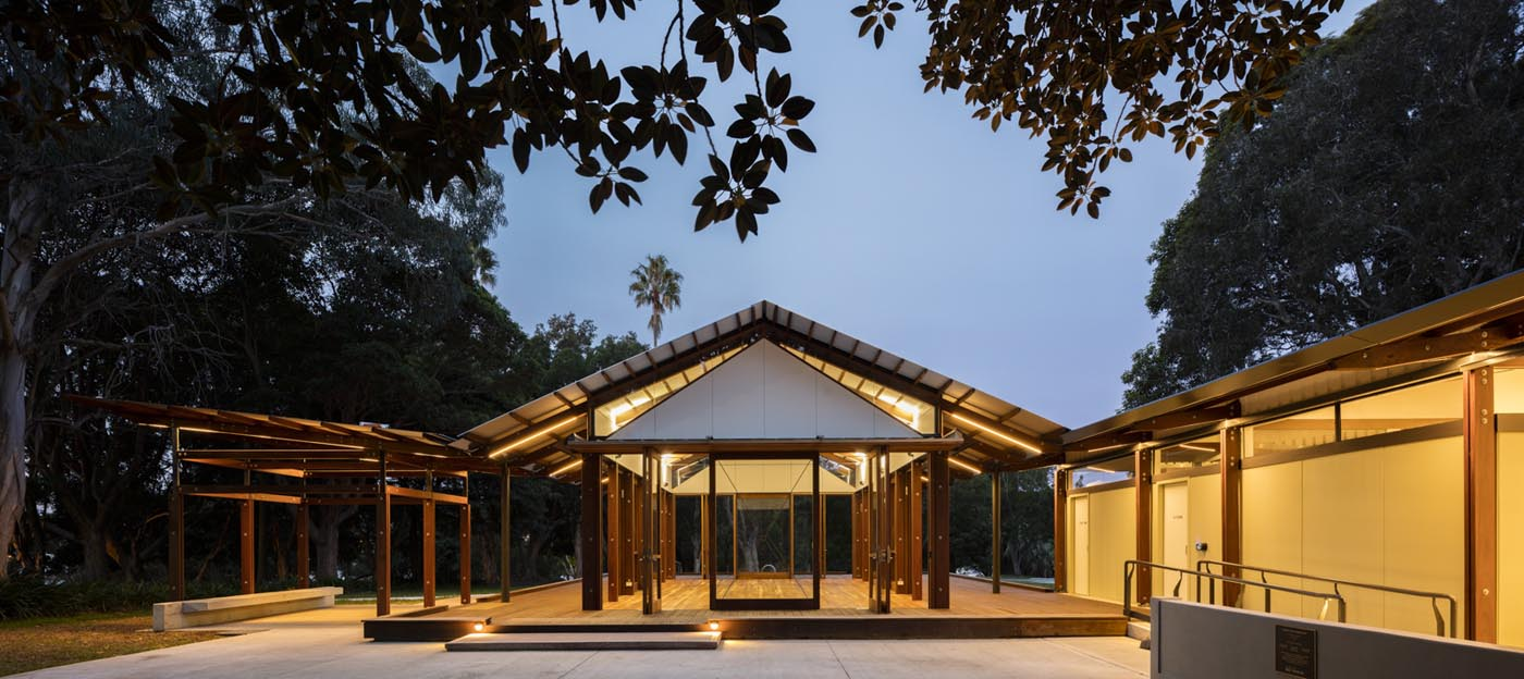 Cabarita Park Conservatory by award winning public architectural firm Sam Crawford Architects. View at dawn to conservatory.