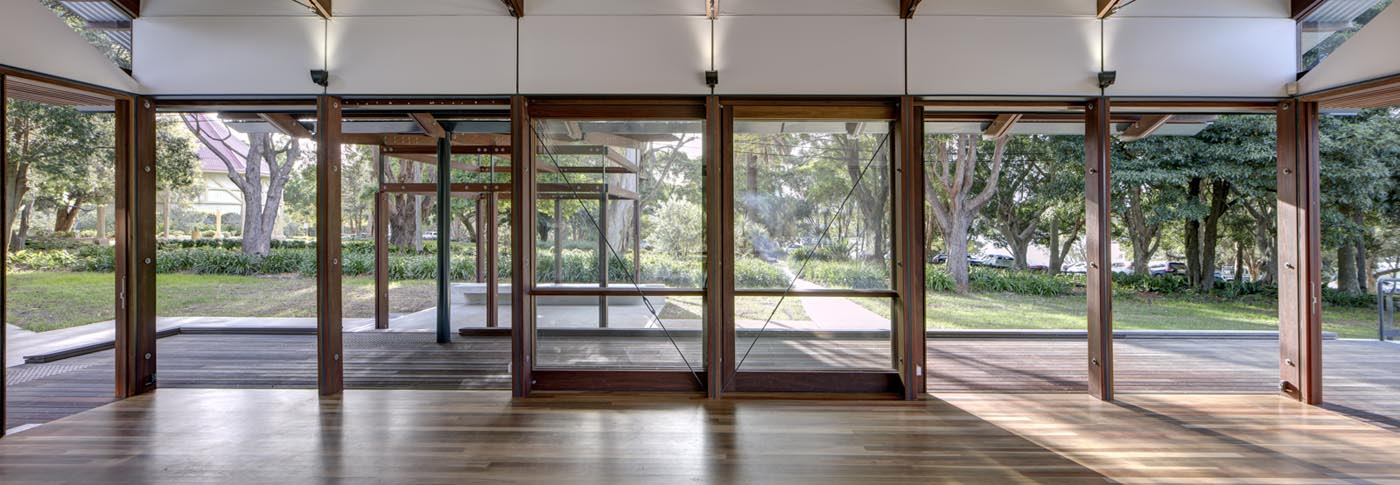 Cabarita Park Conservatory by award winning public architectural firm Sam Crawford Architects. Sliding timber framed doors allow flexible configuration to the function room