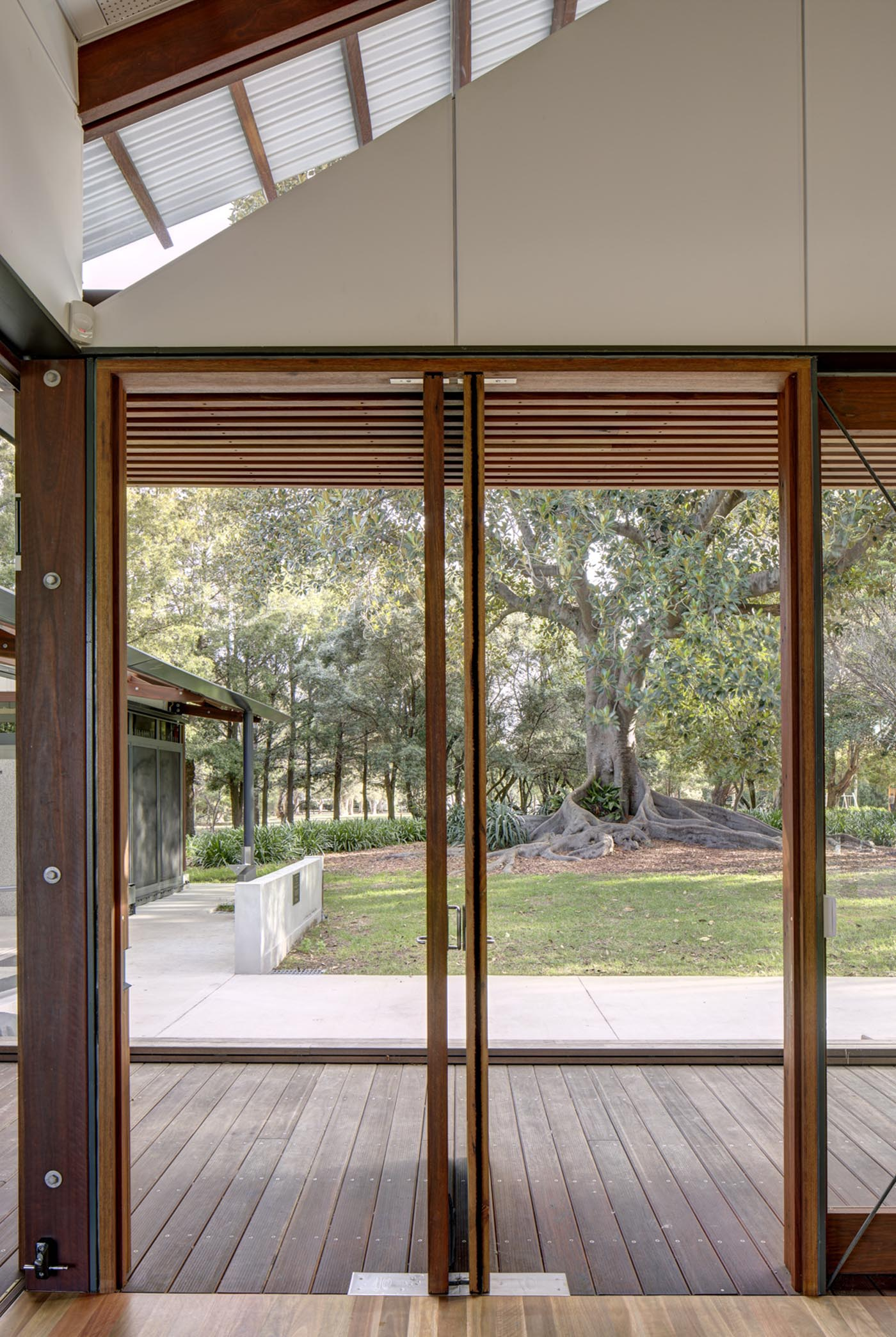 Cabarita Park Conservatory by award winning public architectural firm Sam Crawford Architects. Timber framed doors open to rear